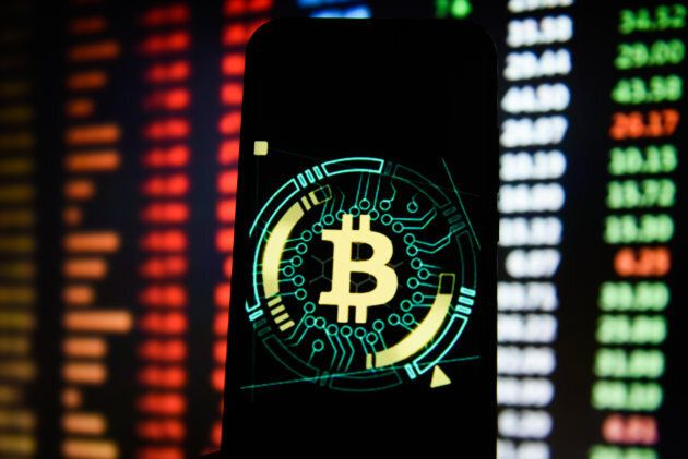 Bitcoin logo is seen on an android mobile