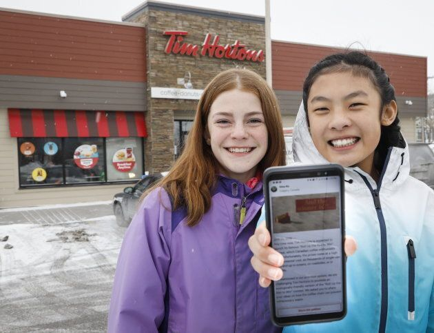 Eve Helman, left, 12 and Mya Chau, also 12, outside a Tim Hortons in Calgary on