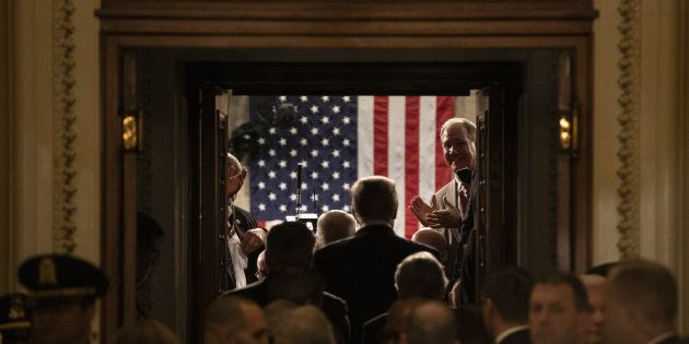 U.S. President Donald Trump arrives to deliver a State of the Union address to a joint session of Congress...