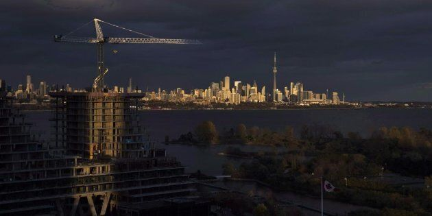 Condominiums under construction in front of the skyline in Toronto, Ont., Tues. Oct. 31, 2017. Home sales...