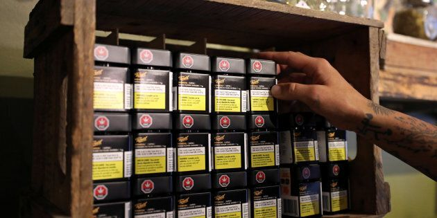 An employee arranges products from cannabis brand Tweed at a retail store in Portugal Cove-St. Philip's,...