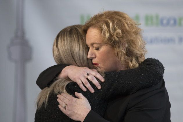 Minister Lisa MacLeod hugs her Parliamentary Assistant Amy Fee, who is a mother of two children with...