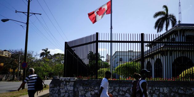 People pass by the Canada's Embassy in Havana, April 16,
