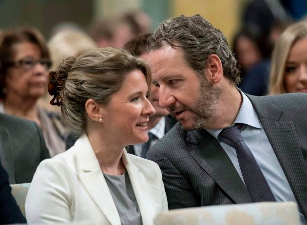 Gerald Butts, speaks with Katie Telford before a swearing in ceremony at Rideau Hall in Ottawa on July 18, 2018.