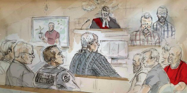 Serial killer Bruce McArthur (centre) attends his sentencing hearing in Toronto on Feb. 4,