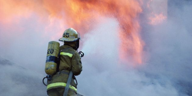 Stock image of a firefighter fighting a