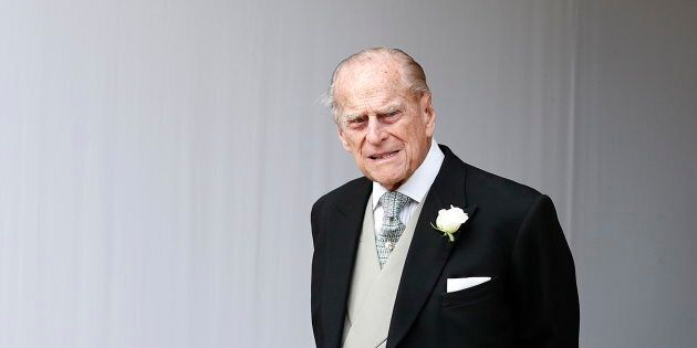 Britain's Prince Philip waits for the bridal procession following the wedding of Princess Eugenie of...
