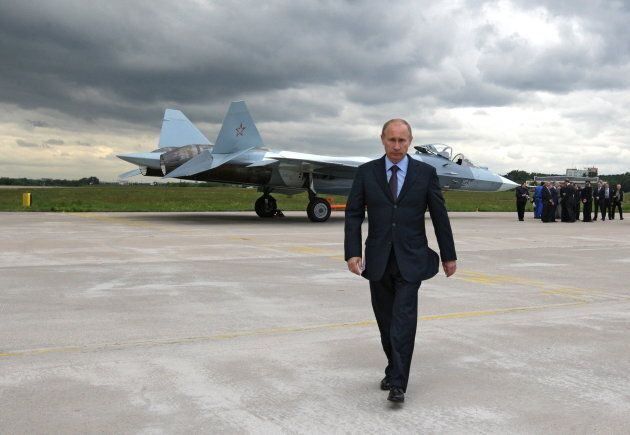 Russian Prime Minister Vladimir Putin walks after inspecting a new Russian fighter jet after its test...