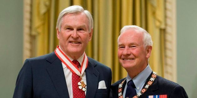 Governor General David Johnston stands with Michael Wilson after investing him as a Companion of the...