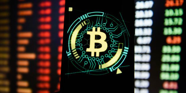 Bitcoin logo is seen on an android mobile phone on Jan. 24,