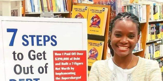 Adeola Omole is pictured next to a sign for her book,