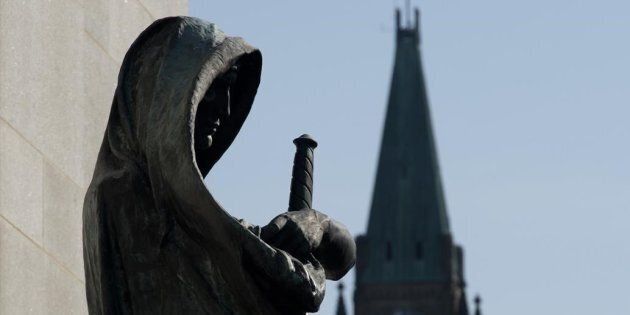 Veritas (Truth) guards the entrance of the Supreme Court of Canada as the Peace tower is seen in the...