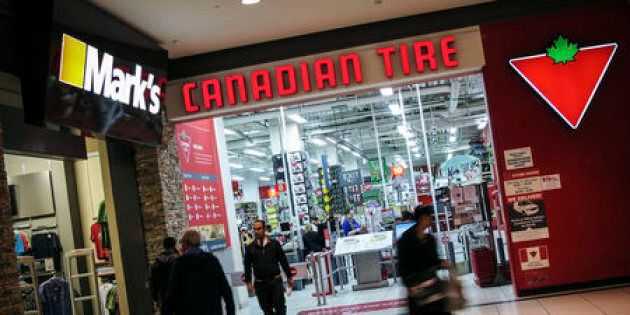 People walk out of a Canadian Tire Store that is located by a Mark's clothing store, which is owned by...