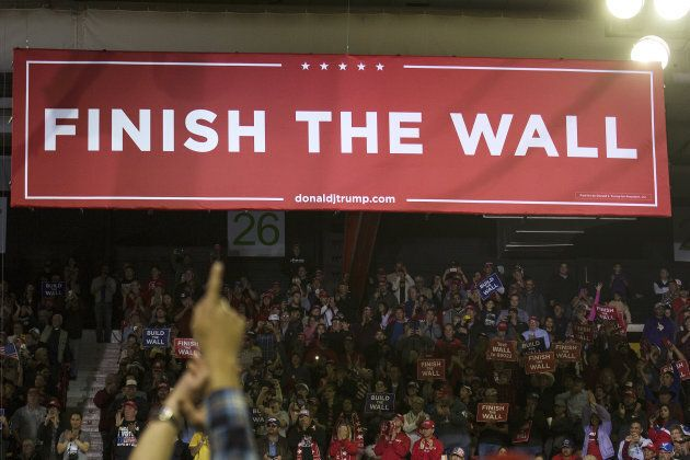 A banner reading 'Finish the Wall' is displayed at a rally for U.S. President Donald Trump in El Paso,...