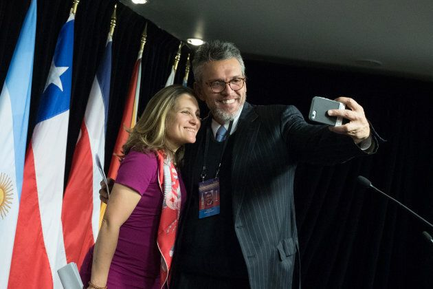 Orlando Viera-Blanco, Venezuela's intern leader's representative in Canada, takes a selfie with Canadian Minister of Foreign Affairs Chrystia Freeland after the press conference for the 10th Lima Group meeting in Ottawa on Feb. 4, 2019.