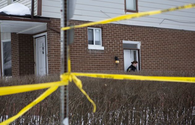 Police monitor the scene outside of a house where a young girl was found dead in Brampton, Ont. on Feb....