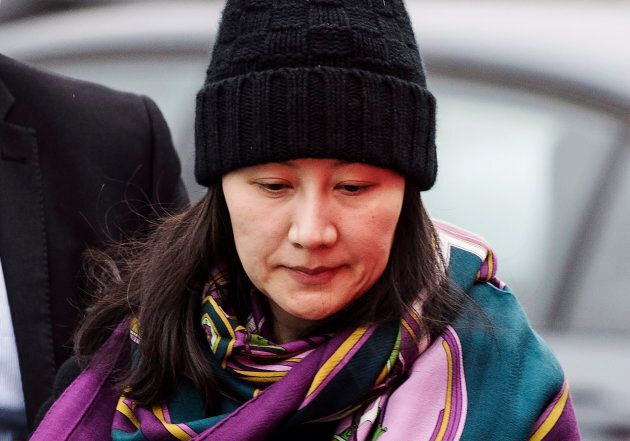 Huawei chief financial officer Meng Wanzhou arrives at a parole office with a security guard in Vancouver,...