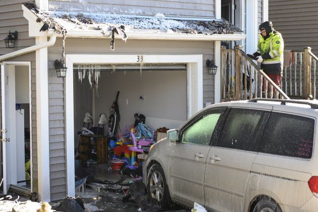 Children's toys are seen in a garage as police and firefighters investigate at the scene of the fatal...
