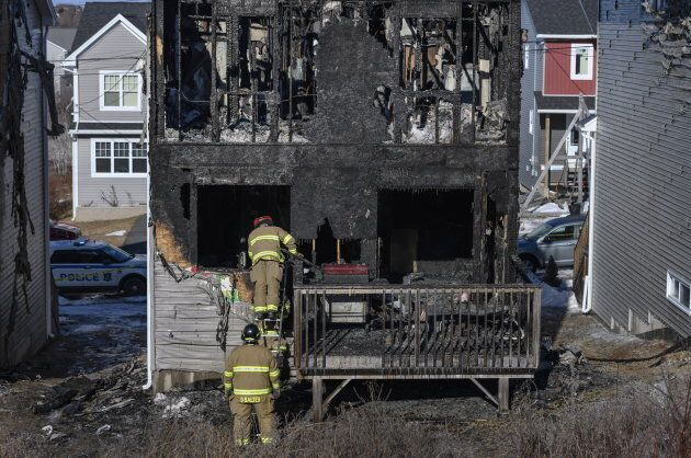 Firefighters investigate following a house fire in the Spryfield community in Halifax on Feb. 19,