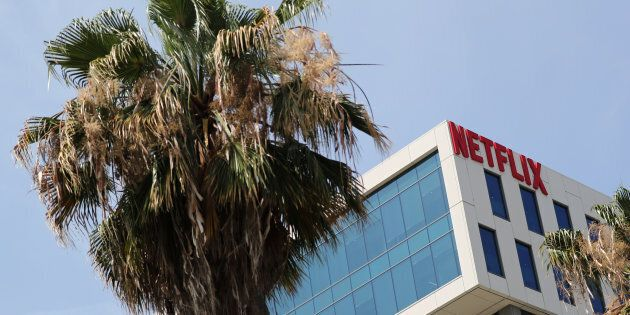 The Netflix logo is seen on their office in Hollywood. The company has officially confirmed that it is...