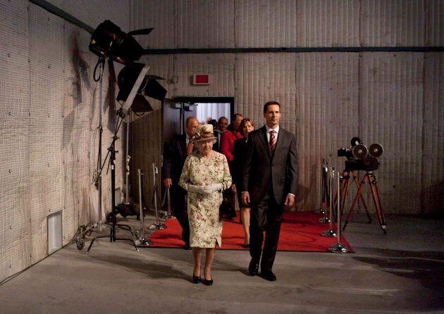 Queen Elizabeth and then-Ontario Premier Dalton McGuinty at a reception at Pinewood Toronto Studios,...