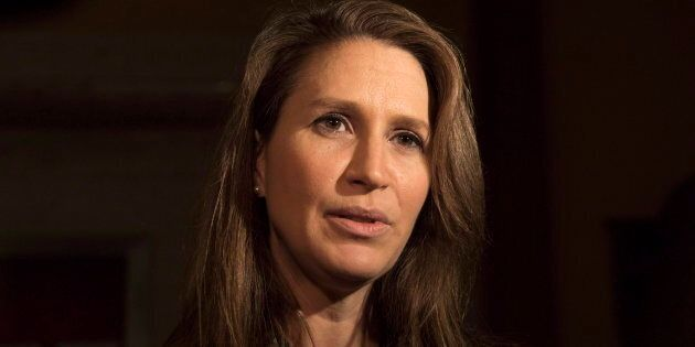 Ontario Minister Caroline Mulroney speaks to reporters following an early morning PC caucus meeting at...