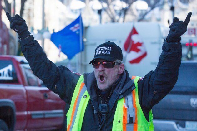 A man wears a 'Make Canada Great Again' hat during the Convoy for Canada protest on Parliament Hill in...