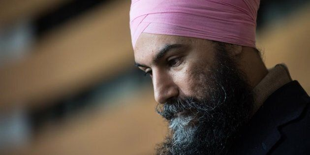 NDP Leader Jagmeet Singh listens while responding to questions after casting his ballot for the federal...