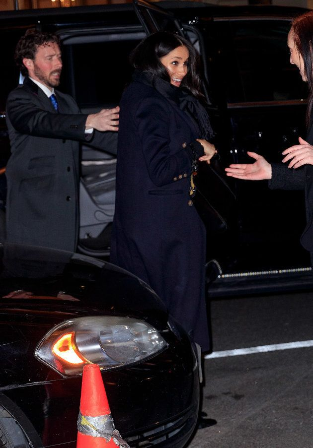 Meghan wore a long, navy coat with black accessories.