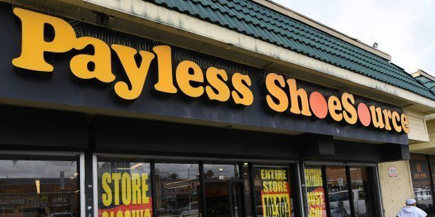 Customers leave a Payless Shoes store in Los Angeles on Feb. 17,