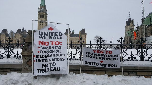 """Many signs were displayed as part of the """"United We Roll"""" convoy rally on Parliament Hill in Ottawa on Feb. 20, 2019."""