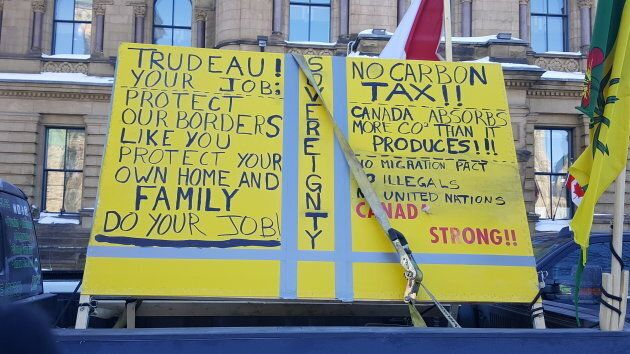 """A sign is affixed onto a truck at the """"United We Roll"""" convoy."""