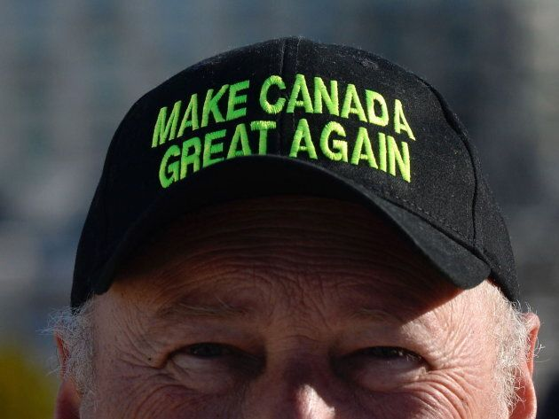 """A protester wears a """"Make Canada Great Again,"""" hat as a convoy of angry Albertans and other westerners rolled up to Parliament Hill in Ottawa on Feb.19, 2019 to protest federal energy and environmental policies."""
