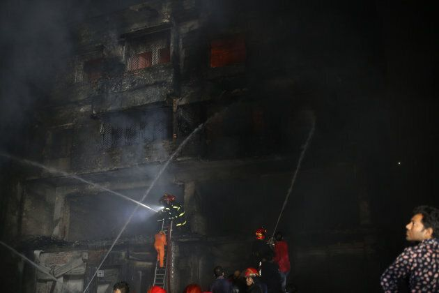 Firefighters try to control fire at Chawkbazar, an old town in Dhaka, on Feb. 21,