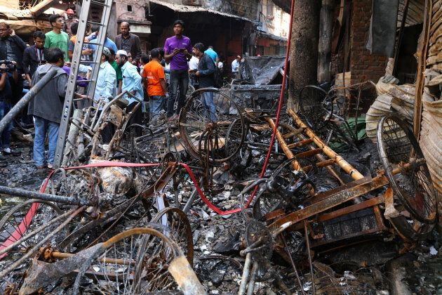 Debris are seen outside the burnt warehouse at Chawkbazar in Dhaka, Feb. 21,