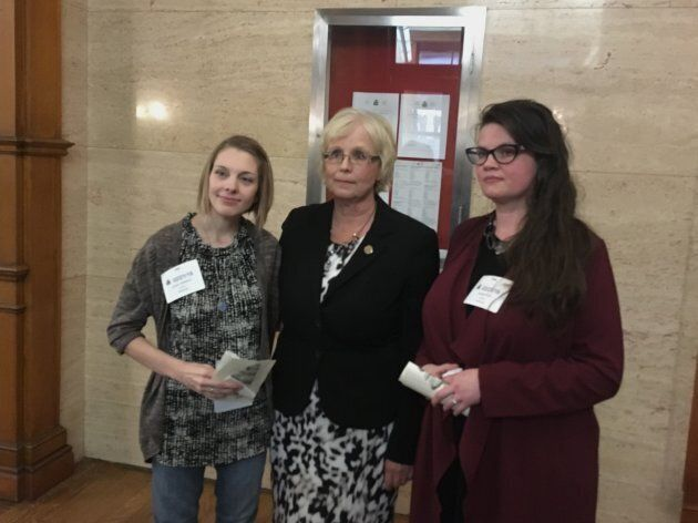 Mothers Sarah Farrants and Brandi Tapp pose with NDP MPP Peggy Sattler at Queen's Park in Toronto on...