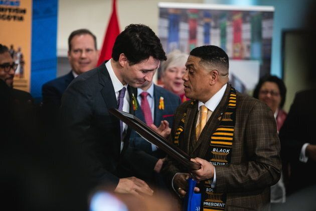 Prime Minister Justin Trudeau embraces Black Cultural Centre president and RCMP Sgt. Craig Smith during...