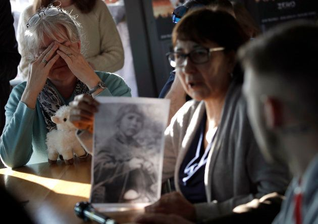 Sex abuse survivor Bernadette Howell (left) cries as she listens to Evelyn Korkamaz, another survivor, during a press conference of members of Ending Clergy Abuse in Rome, Feb. 22, 2019.