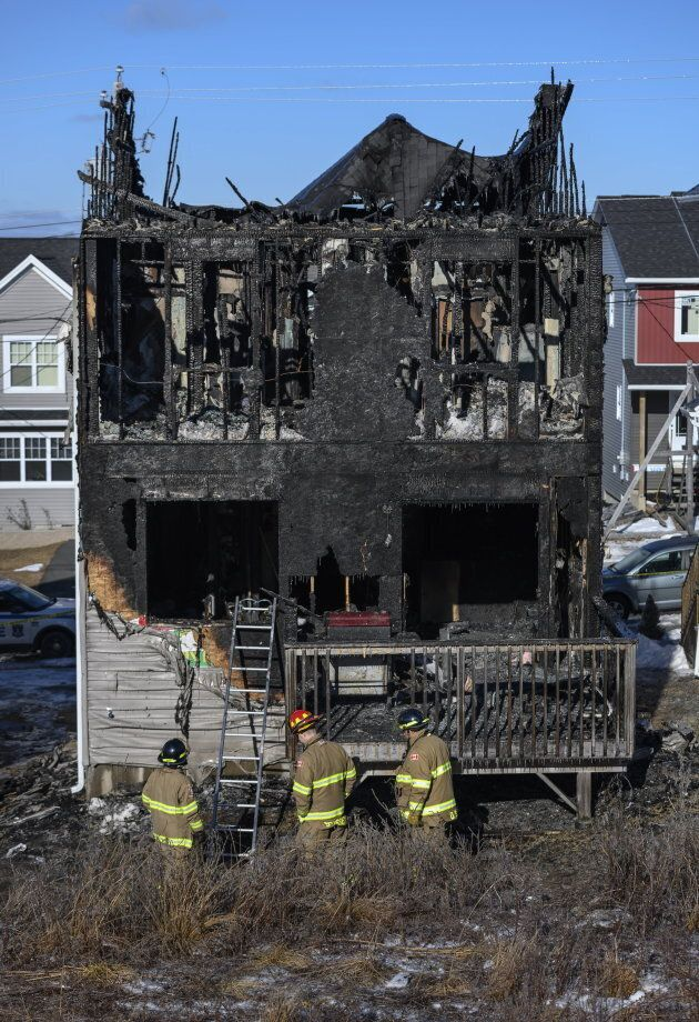 Firefighters investigate following the fire that tore through the Barho family