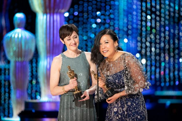 "Becky Neiman-Cobb and Domee Shi accept their Oscar for Best Animated Short for ""Bao."""