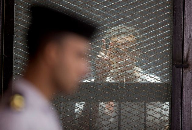 Egyptian photojournalist Mahmoud Abu Zied, known by his nickname Shawkan, flashes a