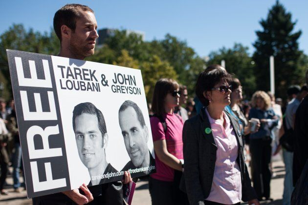 Friends, family and colleagues of Tarek Loubani gather at a rally in Victoria Park in London, Ont. on...