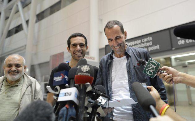 Mahmoud Loubani (left) beams after his son Tarek Loubani (centre) and John Greyson returned to Canada...