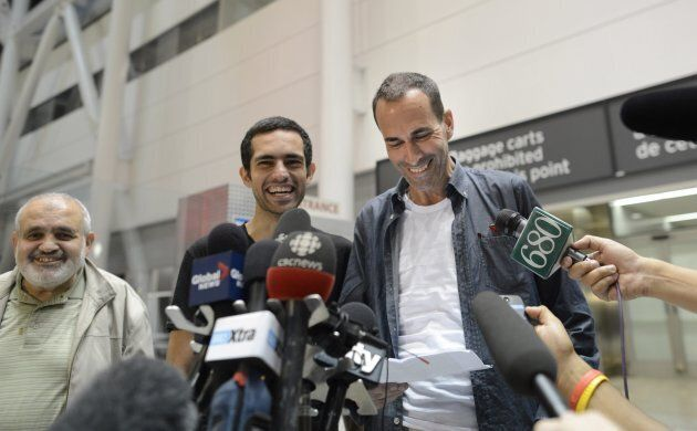 Mahmoud Loubani (left) beams after his son Tarek Loubani (centre) and John Greyson returned to Canada after being imprisoned in Egypt for over a month.