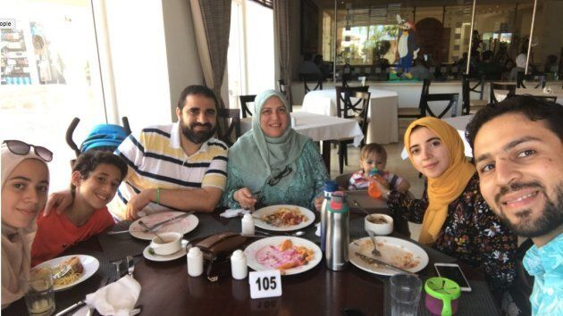 Yasser Ahmed Albaz is pictured with his family