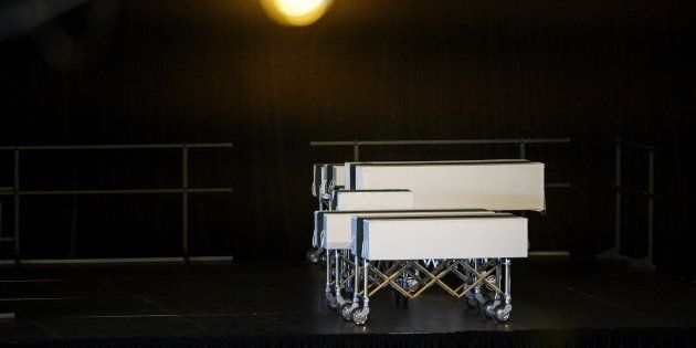 Caskets of the seven Barho siblings rest on a stage during the funeral for the Syrian refugees in Halifax...