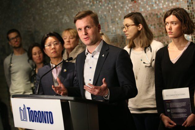 Councillor Joe Cressy and frontline advocates converge on city hall Jan. 31, 2018, as council was set to vote on improving shelter services.