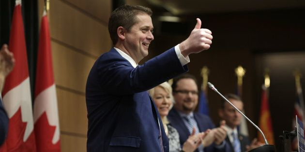 Andrew Scheer, leader of Canada's Conservative Party, gives a thumbs up after speaking during a caucus...