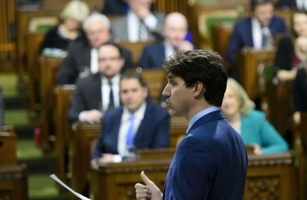 Prime Minister Justin Trudeau stands during question period in the House of Commons on Parliament Hill...