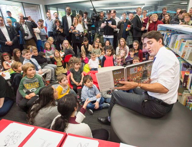 Trudeau reads to children at a library before announcing changes to the Canada Child Benefit on Oct....